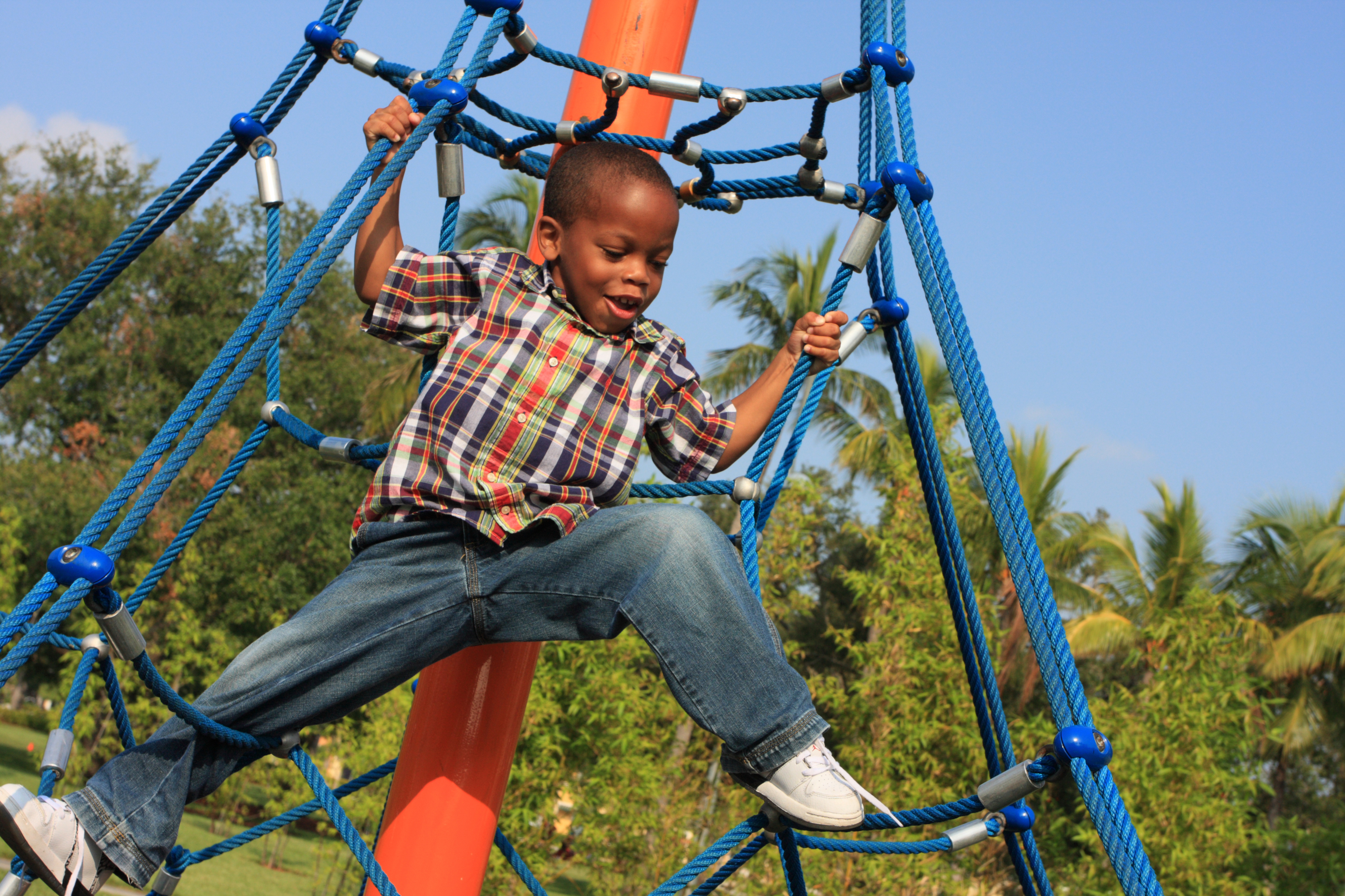 Boy playing on playground. Recess